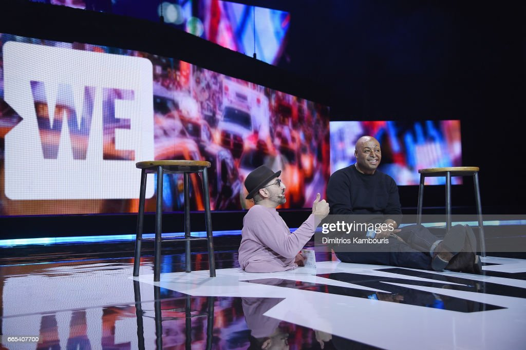 Spencer West and actor J.R. Martinez speak on stage during WE Day New York Welcome to celebrate young people changing the world at Radio City Music Hall on April 6, 2017 in New York City.