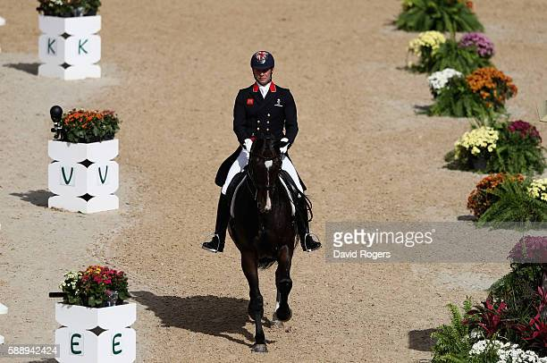 Spencer Wilton of Great Britain riding Super Nova II warms up during the final day of the Dressage Grand Prix event on Day 7 of the Rio 2016 Olympic...