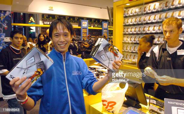 Spencer Yip 22 from Riverside Calif was one of the first to buy the new Nintendo DS video game system at 1201 am inside EB Games at the Universal...