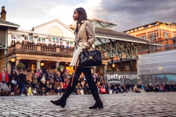Spending a weekend in London, woman walking in downtown