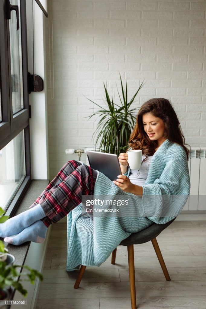 Spending my free time online : Stock Photo