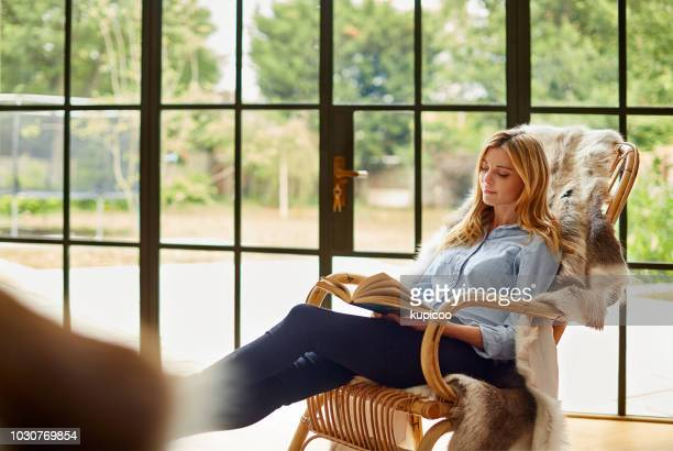 spending some time with a good book - rocking chair stock photos and pictures