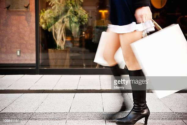 Spending Spree Woman Shopping Rushing with Paper Bags Motion Blur