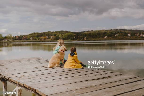 spending time together at the lake - pier stock pictures, royalty-free photos & images
