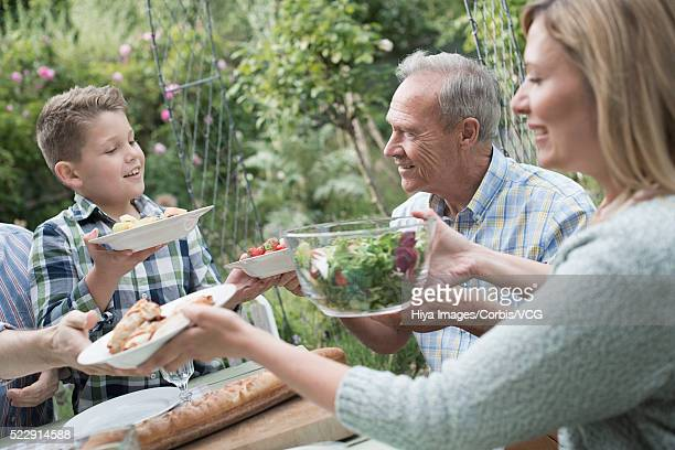 spending time with family in backyard (10-12 years) - 55 59 years stock pictures, royalty-free photos & images