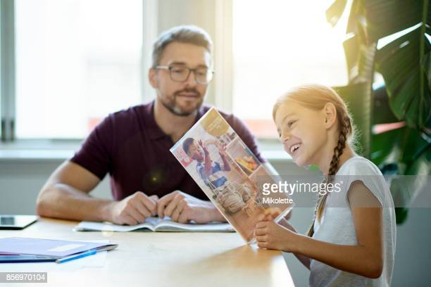 spending time with his daughter - magazine stock pictures, royalty-free photos & images