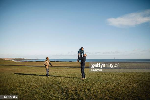 spending time with his son - wide shot stock pictures, royalty-free photos & images