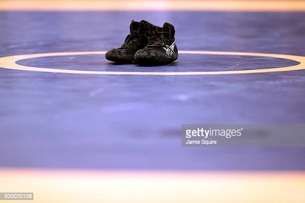 Spenser Mango's shoes are seen on the mat in retirement after losing his Greco-Roman 59kg semifinal match to Jesse Thielke during day 1 of the...