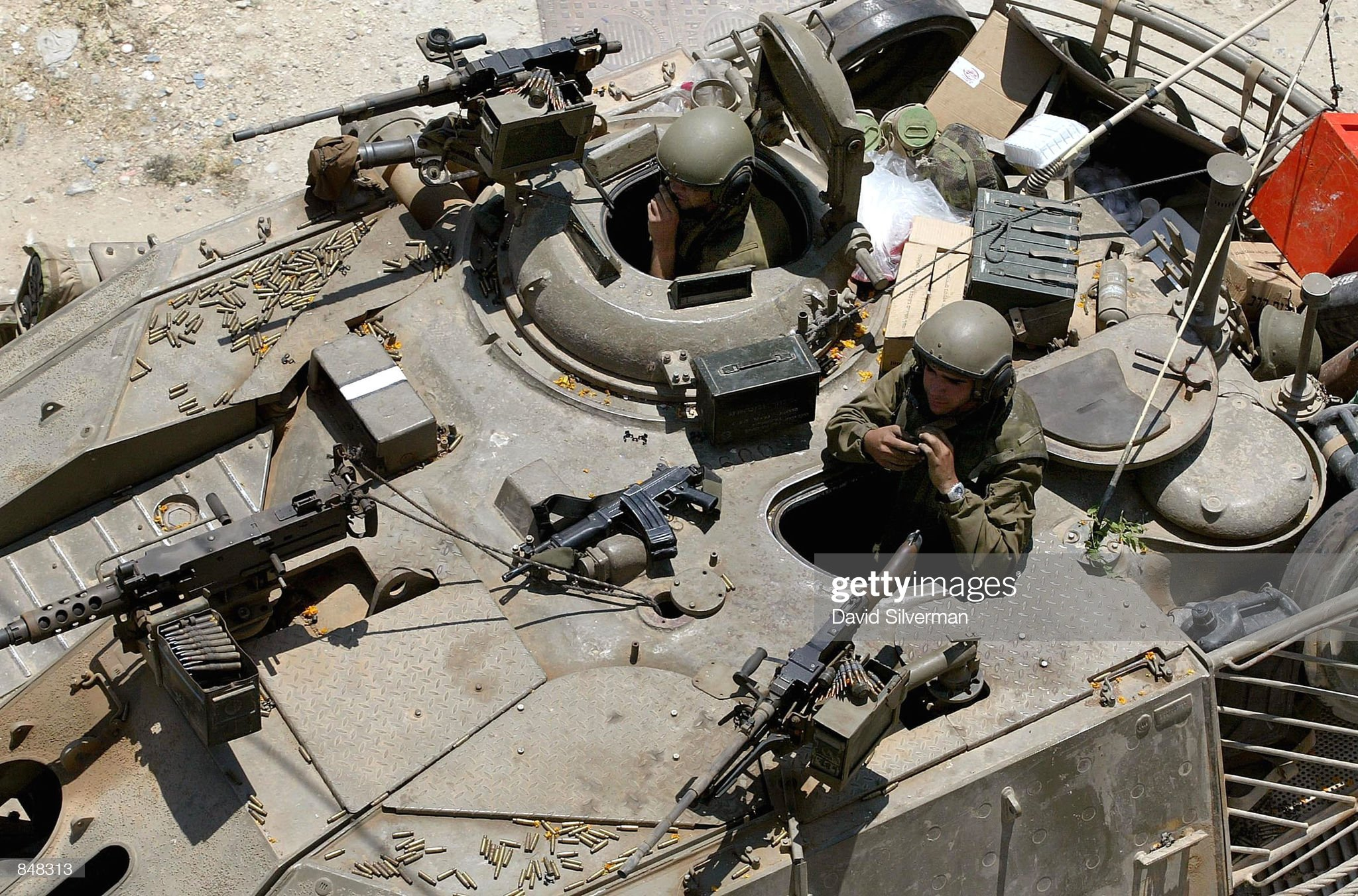 https://media.gettyimages.com/photos/spent-bullet-casings-litter-the-turret-of-an-israeli-tank-as-the-tank-picture-id848313?s=2048x2048