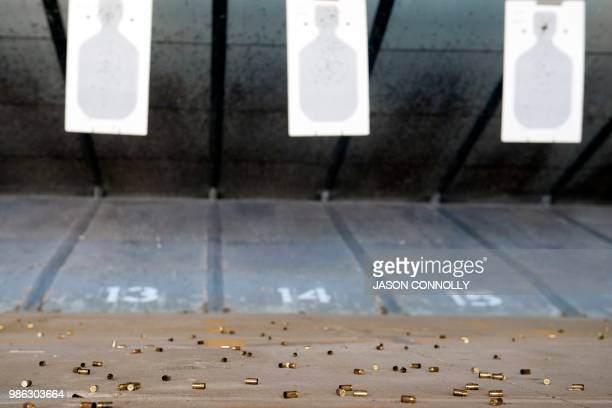 Spent shell casings lie on the ground after school teachers and administrators attending a a threeday firearms course offered by FASTER Colorado have...