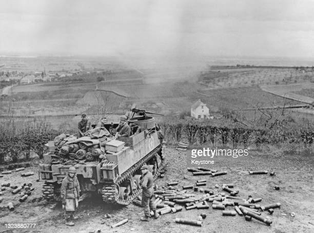 Spent shell casings litter the ground of an M7 Priest 105 mm Howitzer Motor Carriage self propelled gun from the 143rd Cannon Company, 36th Division...