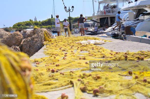 spetses island dock at harbor, greece - spetses stock pictures, royalty-free photos & images