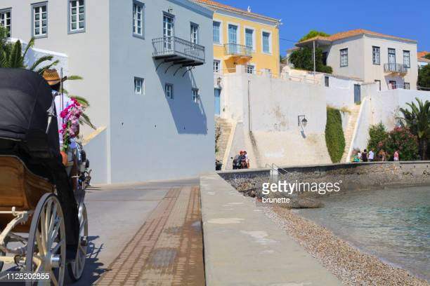 spetses island promenade, greece - spetses stock pictures, royalty-free photos & images