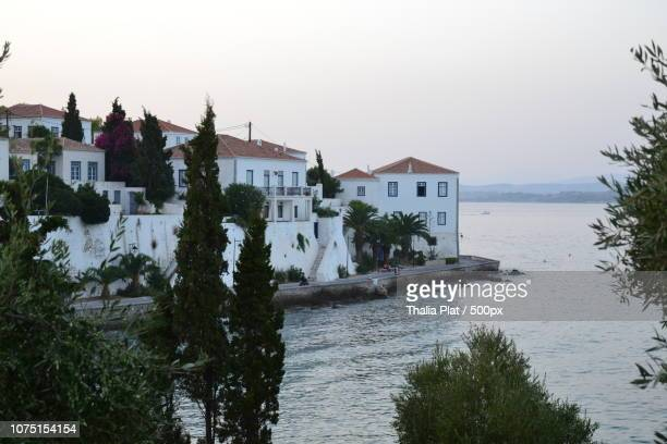 spetses - road to the old port - spetses stock pictures, royalty-free photos & images