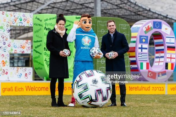 Spezial Advisor of the DFB EURO GmbH Celia Aic mascot Skillzy CEO of the DFB EURO GmbH Philipp Lahm look on during the press conference UEFA EURO...