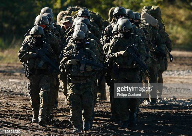 Spezialized soldiers of the Bundeswehr march in formation during the annual military exercises held for the media at the Bergen military training...
