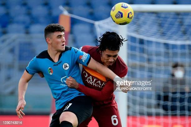 Spezia's Italian forward Roberto Piccoli and Roma's English defender Chris Smalling go for a header during the Italian Serie A football match AS Rome...