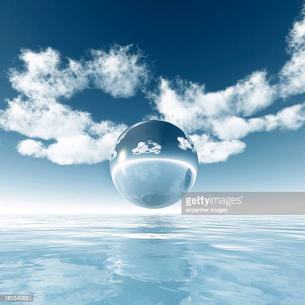Sphere floating above the sea under the blue sky