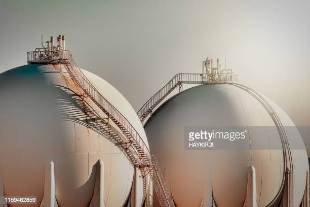 sphere gas tanks in refiney plant - storage tank stock photos and pictures
