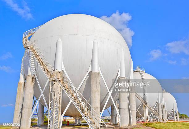 sphere gas tanks on petrochemical plant - storage tank stock photos and pictures