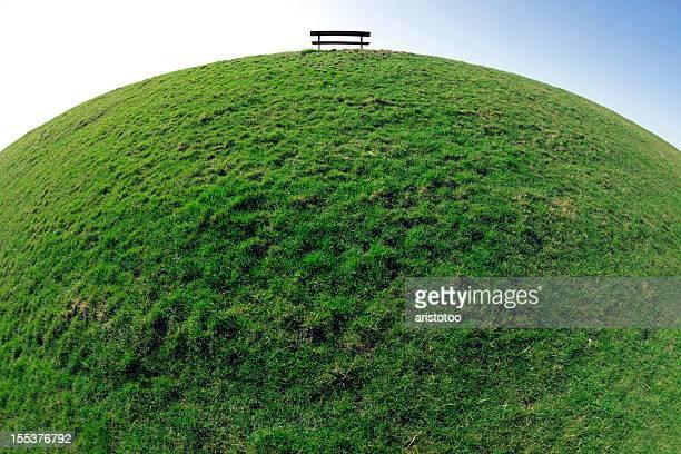 Kugel Gras Hintergrund mit Bank