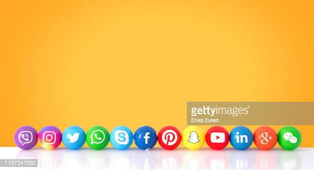 sphere shape of marble social media services icons on an orange desk - social media icons stock pictures, royalty-free photos & images