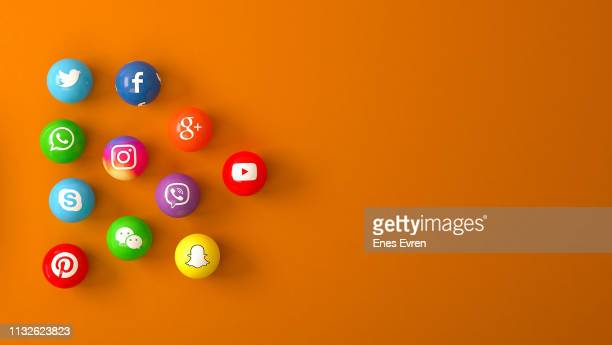 sphere shape of marble social media services icons on an orange desk - social network foto e immagini stock