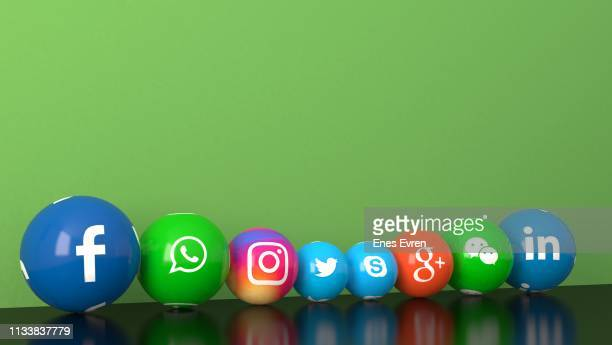 sphere shape of marble social media services icons on green desk - social media icons stock pictures, royalty-free photos & images