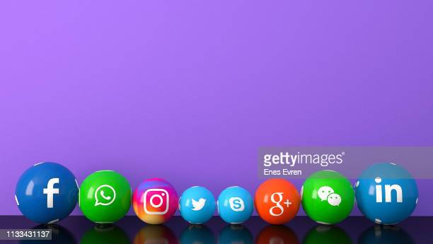 sphere shape of marble social media services icons on purple desk - community logo stock pictures, royalty-free photos & images