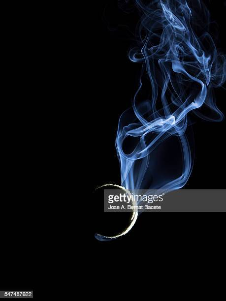 sphere surrounded with smoke in free fall - wispy stock photos and pictures