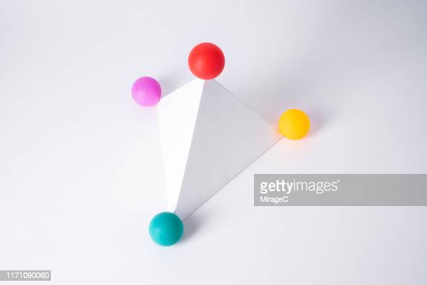 spheres at the corner of pyramid shape - four objects stock pictures, royalty-free photos & images