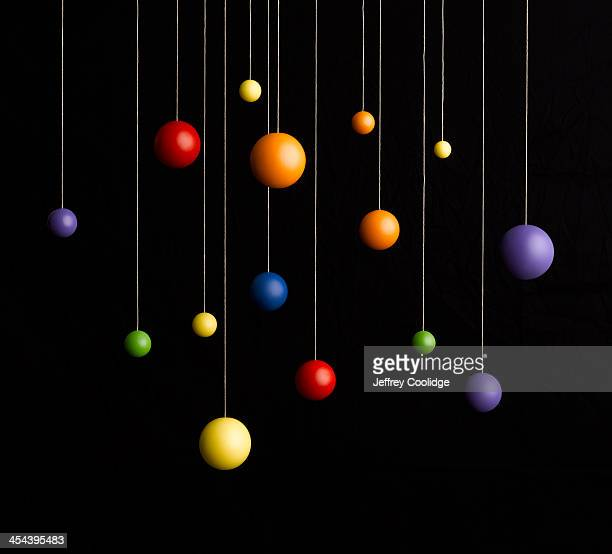 Spheres Hanging on Strings
