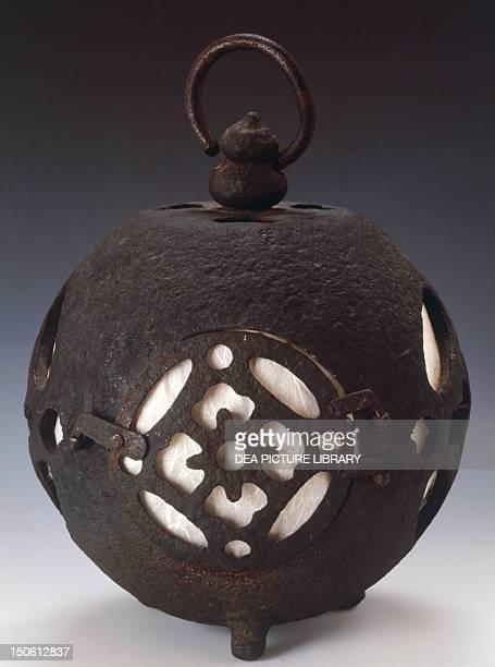 Spherical hanging lantern decorated with fretwork motifs depicting stylized flowers 19th century cast iron height 32 cm Japanese civilization Edo...