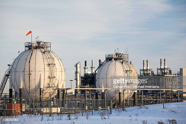 spherical oil tanks and refinery in winter at sunset - blue balls pics stock pictures, royalty-free photos & images