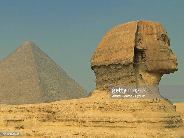 Sphinx And Great Pyramid Against Clear Sky