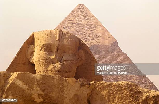 Sphinx And Pyramid Against Clear Sky