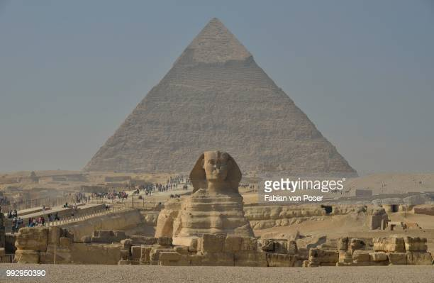 sphinx or great sphinx of giza, lion with a human head, built in the 4th egyptian dynasty around 2700 bc, in front of the pyramid of chephren, giza, egypt - mythology stock pictures, royalty-free photos & images