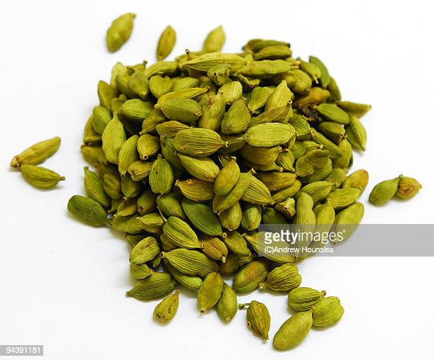 spice - a pile of green cardamom pods - cardamom stock photos and pictures