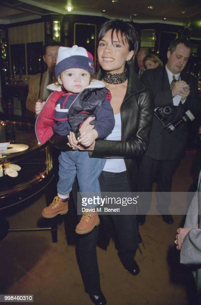 Spice Girls singer Victoria Beckham holding her niece in Bond Street to switch on the Christmas lights, London, 10th November 1999.