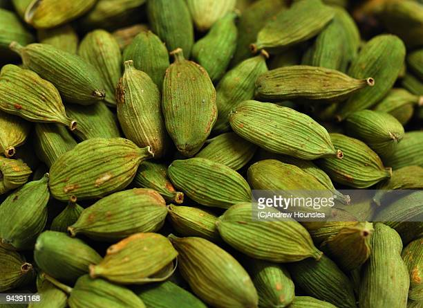 spice - green cardamom pods - close up view - cardamom stock photos and pictures