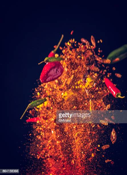 Spice Mix Food Explosion with Chili Peppers and Chili Powder