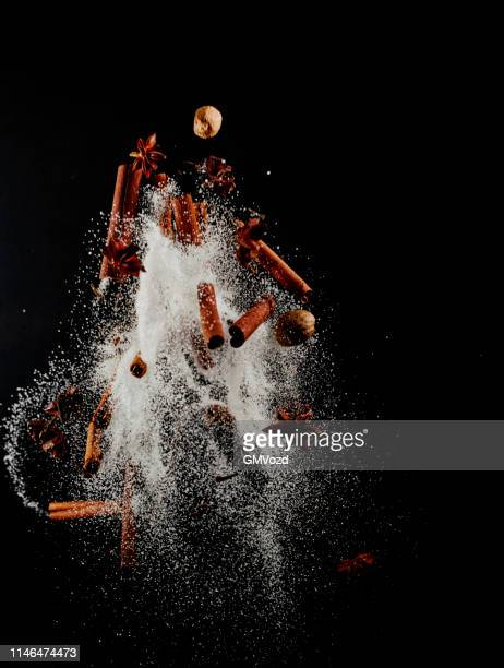 spice mix food explosion with sugar and cinnamon - sugar food stock pictures, royalty-free photos & images