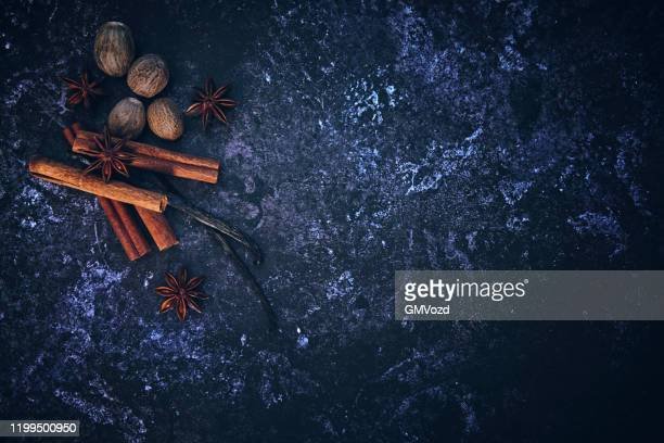 spice mix with cinnamon, nutmeg and star anise on rustic background - anise stock pictures, royalty-free photos & images
