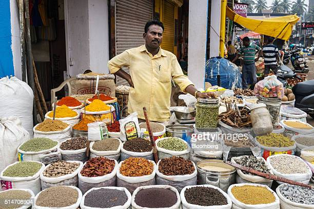 A spice vendor waits for customers at a local street market in Mapusa Goa India on Wednesday March 9 2016 While India is forecast to overtake a...