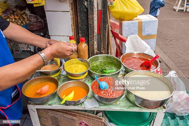 spiced bolws of sauces at the mercado central in lima peru - comida peruana fotografías e imágenes de stock