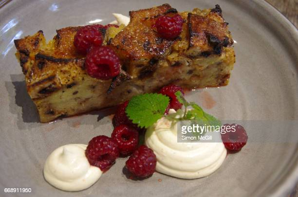 spiced bread pudding served with marscapone cheese, fresh raspberries and yuzu citrus crumble - mascarpone cheese stock pictures, royalty-free photos & images