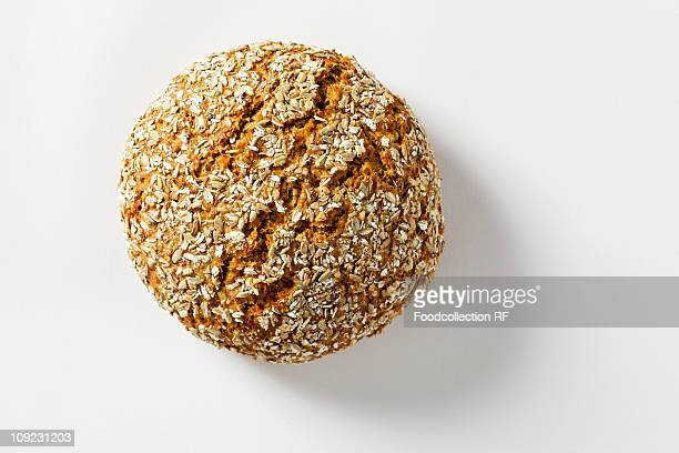 Spiced wholemeal rye bread on white background, close-up