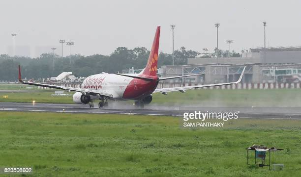 A Spicejet aircraft takes off from the Sardar Vallabhbhai Patel airport in Ahmedabad after heavy rains on July 27 2017 The official death toll from...