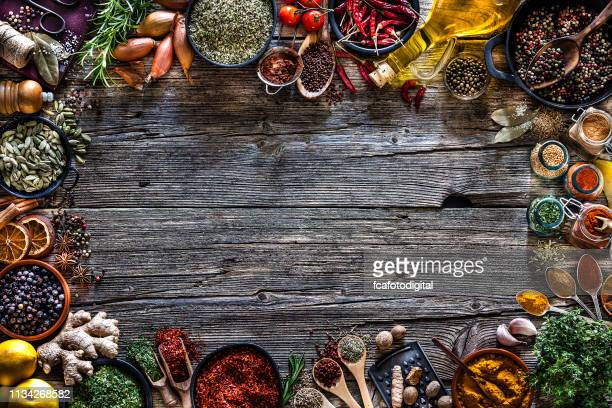 Spices and herbs frame shot from above on rustic wooden table