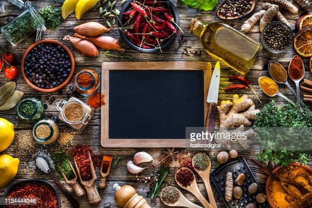spices and herbs frame shot from above on rustic wooden table - kitchen background stock pictures, royalty-free photos & images